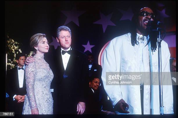 President Bill Clinton and his wife Hillary watch singer Stevie Wonder at an inaugural ball January 20 1997 in Washington DC Clinton attended various...