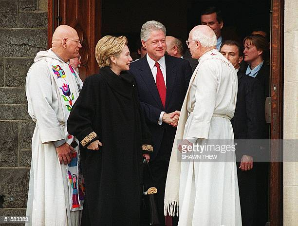 President Bill Clinton and his wife Senator Hillary Rodham Clinton shakes hands with a church official after attending service at Foundry United...