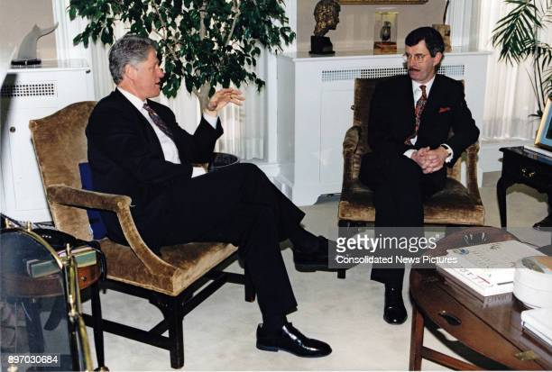 US President Bill Clinton and Irish Deputy Prime Minister Dick Spring talk together in Vice President Al Gore's office in the White House's West Wing...