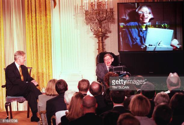 President Bill Clinton and Professor Stephen Hawking in person and on screen watch a scene from 'Star Trek the Next Generation' during a 'Millennium...