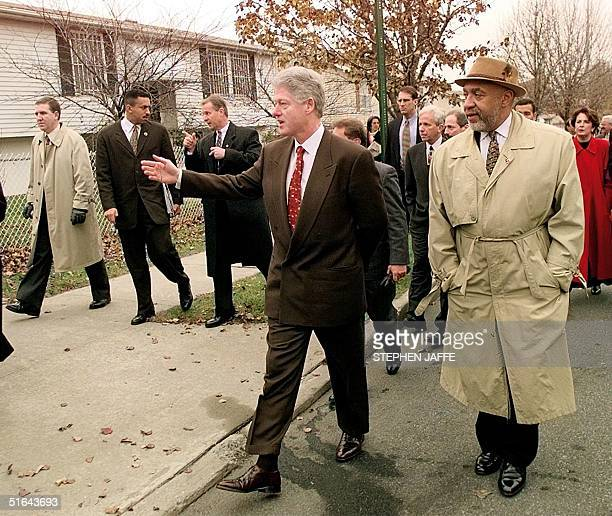 President Bill Clinton and Ralph Porter a neighborhood leader tour Charlotte Gardens 10 December in the Bronx neighborhood of New York Clinton...
