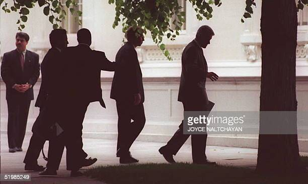 President Bill Clinton and unidentified staff arrive at the White House 26 May after attending church services at the Foundry Methodist Church in...