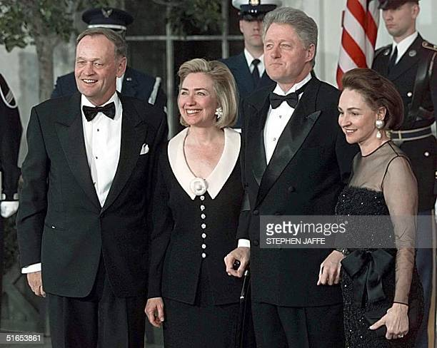 President Bill Clinton and US First Lady Hillary Rodham Clinton stand with Canadian Prime Minister Jean Chretien and his wife Aline Chretien while...