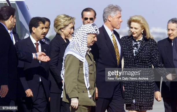 President Bill Clinton and wife Hillary are greeted by Palestinian Leader Yasser Arafat and wife Suha upon their arrival at Gaza International...