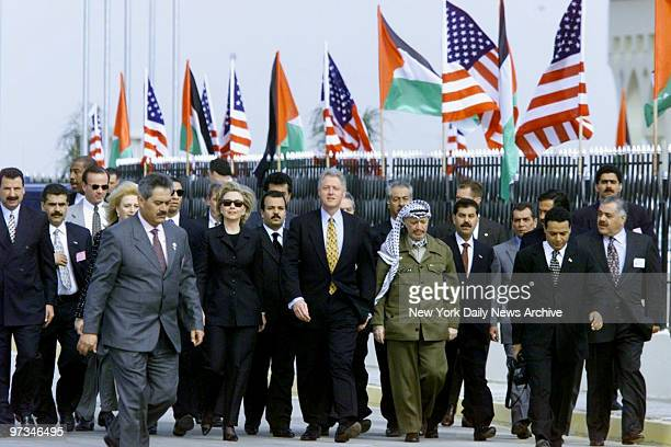 President Bill Clinton and wife Hillary are met by Palestinian Leader Yasser Arafat and wife Suha , upon their arrival at Gaza International Airport.