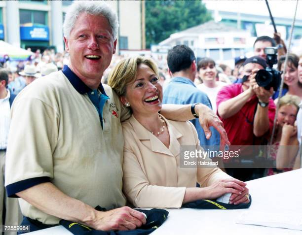 President Bill Clinton and wife Hillary Clinton share a laugh September 3, 2000 while waiting for food at the New York State Fair in Syracuse, New...