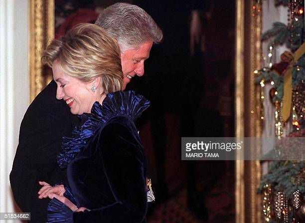 President Bill Clinton and wife Hillary Rodham Clinton are pictured during a ceremony honoring Kennedy Center awardees 05 December 1999 at the White...