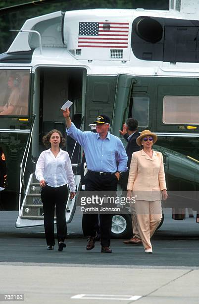 President Bill Clinton and wife Hillary Rodham Clinton arrive at Westchester County airport with first daughter Chelsea Clinton aboard Marine One...