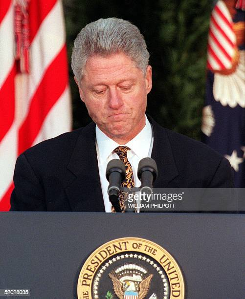 President Bill Clinton apologizes to the nation from the Rose Garden of the White House 11 December in Washington DC A congressional panel approved a...