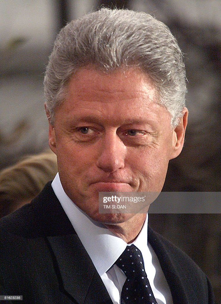 US President Bill Clinton appears after making a statement to the press 19 December in Washington following his impeachment by the US House of Representatives. Clinton rejected calls for his resignation after the House impeached him on one count of perjury and obstruction of justice. AFP PHOTO (ELECTRONIC IMAGE) Tim SLOAN