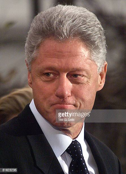 President Bill Clinton appears after making a statement to the press 19 December in Washington following his impeachment by the US House of...