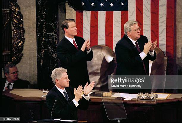 President Bill Clinton applauds an audience member during his State of the Union speech before a joint session of Congress on January 20 1999 He is...
