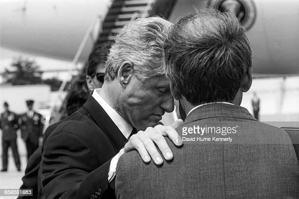 President Bill Clinton at JFK International Airport, where he spoke about the crash of TWA Flight 800, talks with New York Major Rudy Giuliani on...