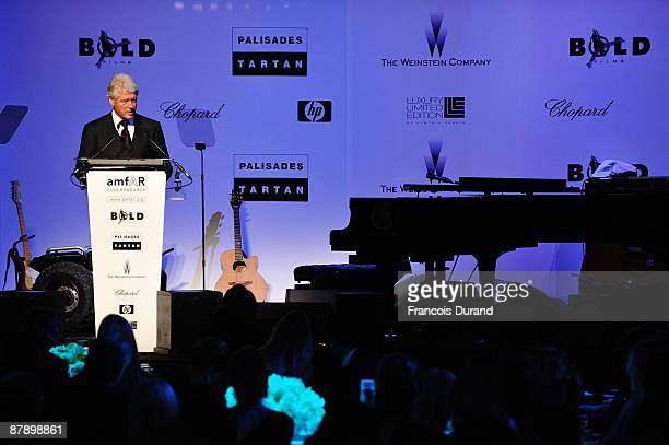 President Bill Clinton attends the amfAR Cinema Against AIDS 2009 show at the Hotel du Cap during the 62nd Annual Cannes Film Festival on May 21 2009...