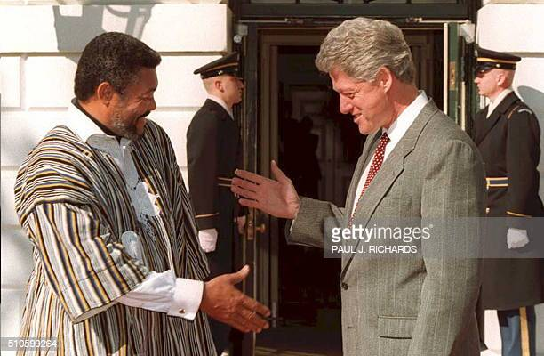 US President Bill Clinton bids farewell to Jerry Rawlings the president of Ghana after meetings at the White House in Washington 09 March President...