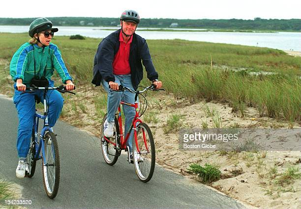 President Bill Clinton bikes with his wife Hillary Clinton during their vacation on Martha's Vineyard