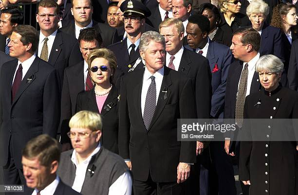 S President Bill Clinton center and his wife Hillary Clinton left lead a delegation of senators congressman and governors to a memorial service for...