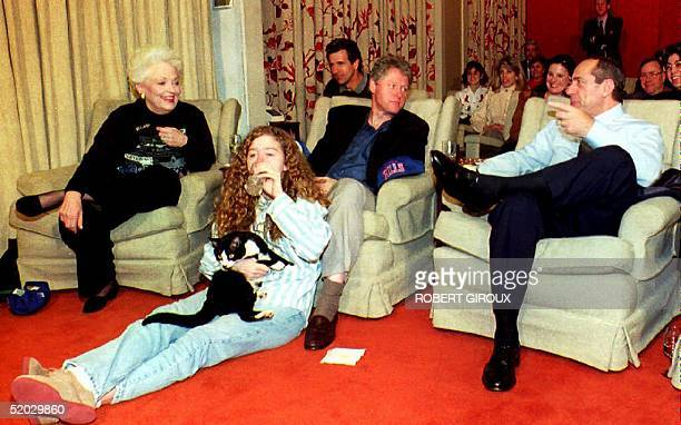 S President Bill Clinton chats with New York Governor Mario Cuomo 31 January 1993 at the White House while watching Super Bowl XXVII on television At...