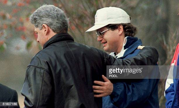 S President Bill Clinton comforts his halfbrother Roger 07 January 1994 in Hot Springs AR after paying their respects to their mother Virginia Kelley...