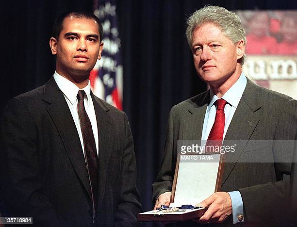 US President Bill Clinton confers America's highest civilian honor on confined Myanmar opposition leader Aung San Suu Kyi to her son Alexander Aris...