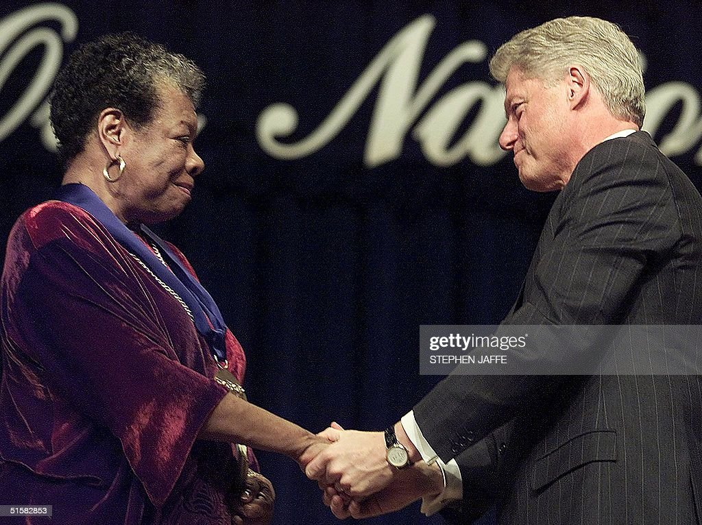 US President Bill Clinton(R) congratulates poet/writer Maya Angelou(L) after presnting her with the National Medal of Arts during ceremonies 20 December, 2000 at Constitution Hall in Washington, DC. The award is presented to individuals for their contributions to the arts in America. AFP PHOTO/ Stephen JAFFE
