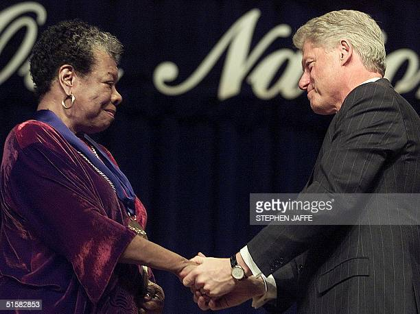 President Bill Clinton congratulates poet/writer Maya Angelou after presnting her with the National Medal of Arts during ceremonies 20 December, 2000...
