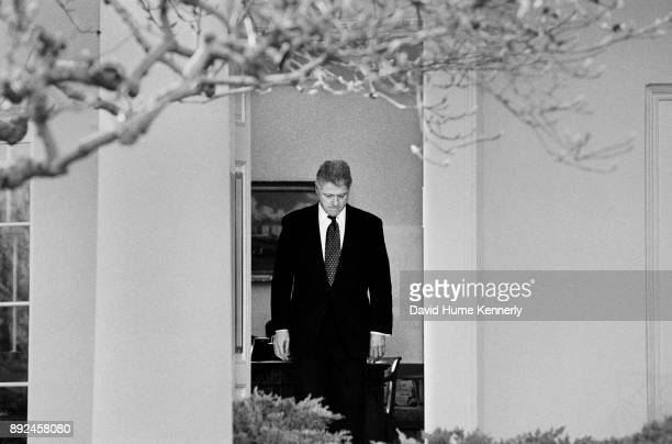 President Bill Clinton emerges from the Oval Office to talk to the media after learning that the U.S. Senate voted to acquit him of the charges of...