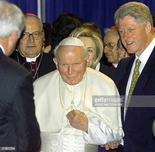 President Bill Clinton escorts Pope John Paul II 26 January during a meeting at Lambert International Airport in St Louis Clinton welcomed the...