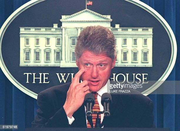 President Bill Clinton expresses his sympathy 18 July at a press conference at the White House in Washington DC for the victims and their familes of...