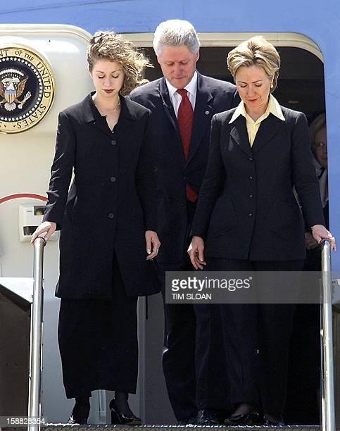 US President Bill Clinton First Lady Hillary Rodham Clinton and daughter Chelsea arrive at the Northwest Arkansas Regional Airport aboard Air Force...