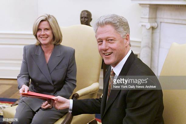 President Bill Clinton gets a report on the situation in Nicaragua and Honduras from Tipper Gore, who just returned from the region where she...