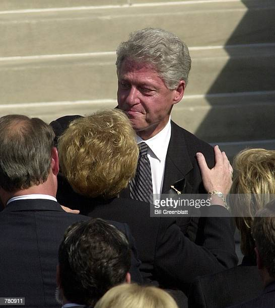President Bill Clinton gives a hug to Jean Carnahan widow of the late Missouri Governor Mel Carnahan during a memorial service on the south lawn of...