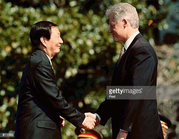 President Bill Clinton greets Chinese Premier Zhu Rongji at the White House April 8, 1999. President Clinton welcomed the Chinese Premier saying it...