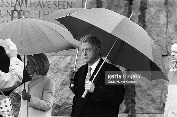 S President Bill Clinton greets the crowd at the FDR memorial with First Lady Hillary Clinton on February 6 1998