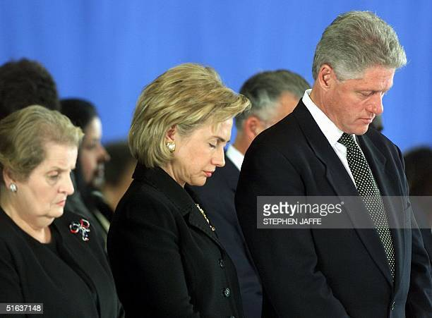 President Bill Clinton Hillary Rodham Clinton and US Secretary of State Madeleine Albright bow their heads during prayer 13 August at a memorial...