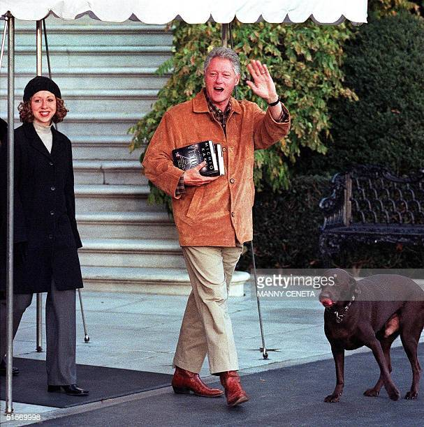 President Bill Clinton his daughter Chelsea and family dog Buddy leaves the White House for a weekend retreat at Camp David Maryland 22 November 2000...
