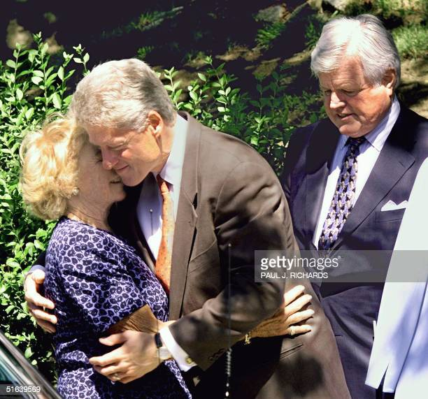 President Bill Clinton hugs Ethel Kennedy widow of Robert F Kennedy beside US Senator Edward Kennedy 05 June in Boston MA on the 30th anniversary of...