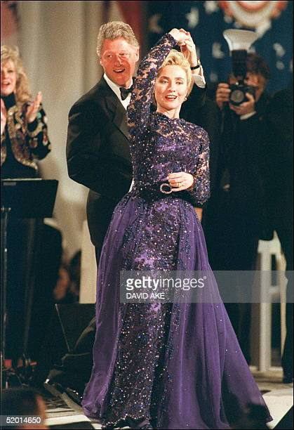 President Bill Clinton in a picture taken 20 January 1993 in Washington DC holds First Lady Hillary Clinton during an on stage dance as they stopped...