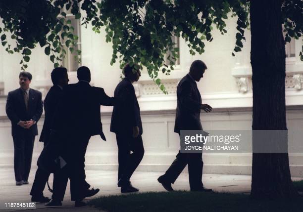 US President Bill Clinton in file picture taken 26 May 1996 in Washington DC and unidentified staff arrive at the White House after attending church...