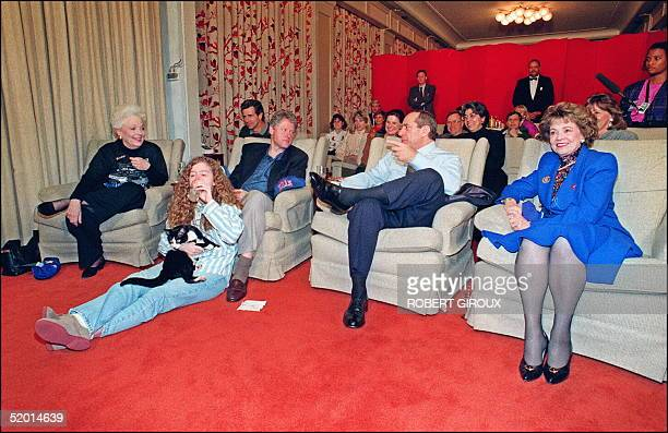 President Bill Clinton in file picture taken 31 January 1993 at the White House Washington DC chats with New York Governor Mario Cuomo as Texas...