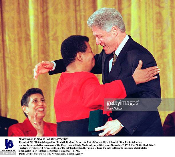 President Bill Clinton is hugged by Elizabeth Eckford former student of Central High School of Little Rock Arkansas during the presentation ceremony...