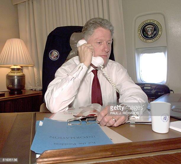 President Bill Clinton is updated on a secure Air Force One line on the status of the Middle East peace talks 16 October by US Secretary of State...