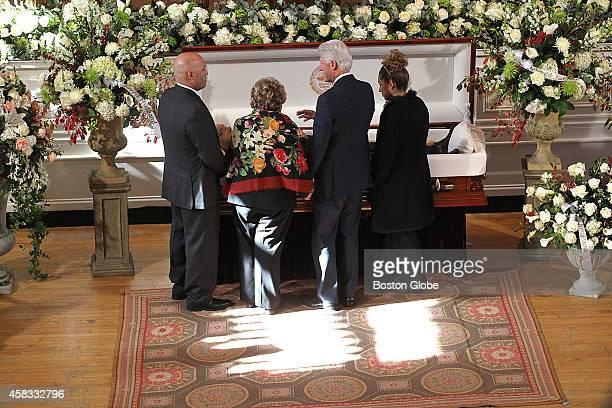 President Bill Clinton joins Angela Menino and her two children Thomas Jr and Susan Fenton to say goodbye to the late Boston Mayor Thomas Menino lies...