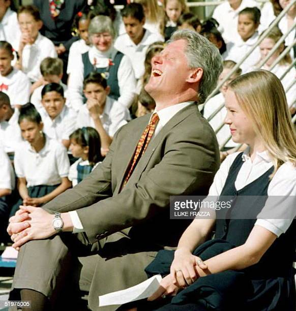 President Bill Clinton laughs as the Unified School District Principal relates a story about his 4th graders' lack of support for the proposal of...