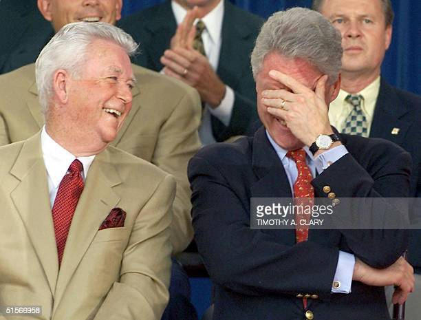 President Bill Clinton laughs as US Team Captain Ken Venturi looks on after Clinton was introduced as the World's Number One golfer by International...