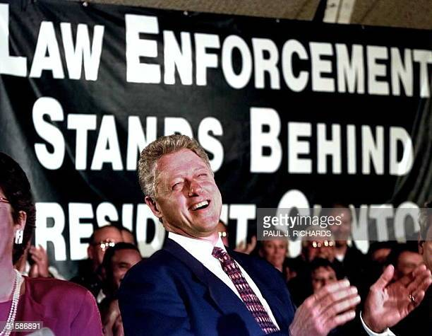 President Bill Clinton laughs during his introduction as members of the Fraternal Order of Police applaud prior to the president's address on crime...