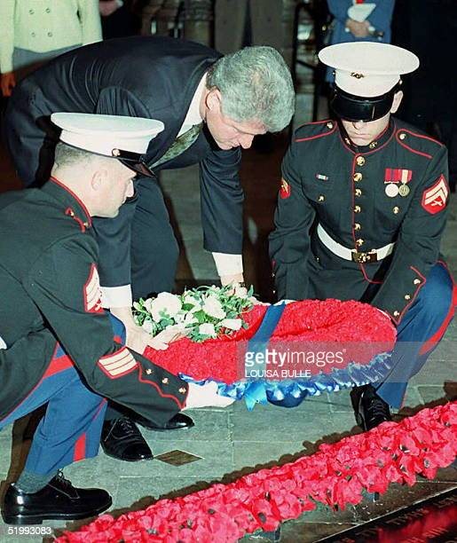 President Bill Clinton lays a wreath at the tomb of the Unknown Soldier in Westminster Abbey 29 November at the start of his historic threeday visit...