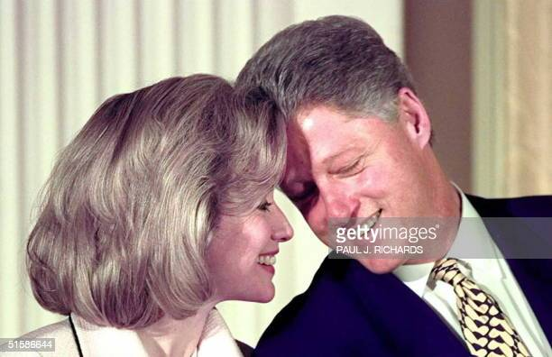 President Bill Clinton leans towards US First Lady Hillary Clinton 17 July in the East Room of the White House during a ceremony for the Friends of...
