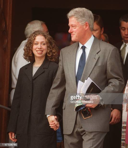 US President Bill Clinton leaves Foundry Methodist church 20 December in Washington DC with his daughter Chelsea Clinton has become the second...