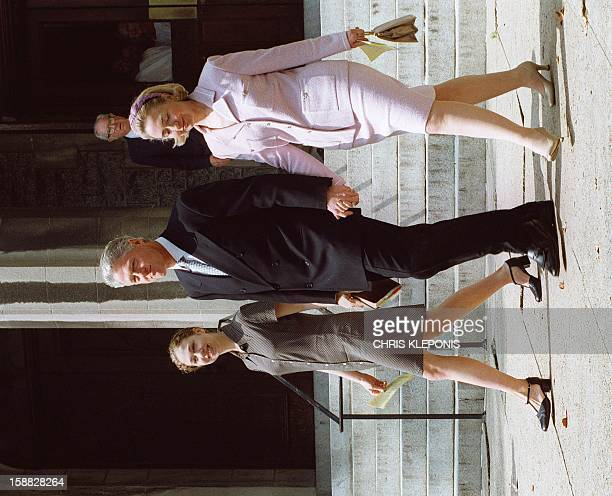 US President Bill Clinton leaves Foundry Methodist Church in Washington DC 14 September with his daughter Chelsea and his wife Hillary This is...